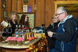 Photo by Elaine Howell. Visitors sample the spirits at High Mark Distillery at its grand reopening Saturday in Sterling.