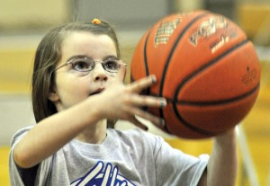 Photo by Joseph Robertia, Redoubt Reporter. Delaney Smith, 8, of Kalifornsky Beach Elementary School, prepares to throw a basketball during the Elks Hoop Shoot, held in the gymnasium of Soldotna Prep on Saturday. Smith won her age division and will move on to state-level competition.