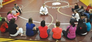 The self-defense class was taught by a visiting instructor, Kati Gibler, who has practiced judo for 25 years. The class drew a range of ages of women and teens, looking to gain information and defense strategies.