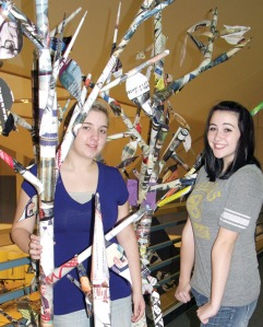 Heidi Kaser and Sadie Averill crafted six birchlike trees decorated with political flyers from the general election.