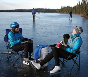 Sue Seggerman, left, and Gail Moore take a break while Jim Bennett and Tony Eskelin make another lap around Bottenintnin Lake on Saturday. Conditions weren't great, skaters said, but it beat being inside.