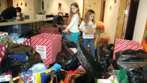 Photos by Jenny Neyman, Redoubt Reporter. Danika (left) and Isaak Winslow help sort and count donations for Toys for Tots on Monday at the Kenai Visitors and Cultural Center. Between fundraisers and donations, the program will provide 1,605 toys to Kenai Peninsula families in need this year.