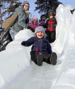 A thrilled participant tours the dragon slide at the Soldotna Sports Center during Peninsula Winter Games festivities in 2012.