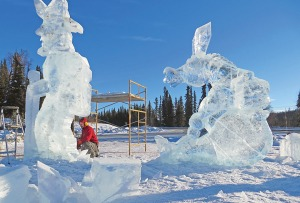 Derek Stanton carves ice sculptures outside the Soldotna Sports Center for the 2013 Peninsula Winter Games.