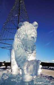 Redoubt Reporter file photos. The Peninsula Winter Games are usually accompanied by ice sculptures around town, which are a highlight of January for residents. This year, however, weather remained too warm for enough ice to form. This bear was a creation for the 2013 games.