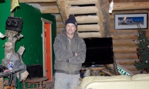 Photos by Jenny Neyman, Redoubt Reporter Tyler Johnson in his work-in-progress cabin south of Soldotna.