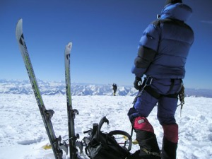 Photo courtesy of Tyler Johnson. Tyler Johnson takes in the view from the summit of Cho Oyu on the Tibet-Nepal boarder in 2007.
