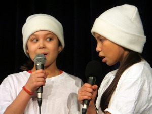 A young duo performs at a previous Dilly Capers show.