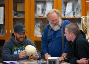 Photos courtesy of Kenai Peninsula College. Dr. David Wartinbee works with students in one of his classes in the biology department. He's retiring at the end of this semester.