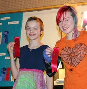 """Photos courtesy of River City Academy. Dawnie Altman and Amelia Johnson took second place in the middle school division, personal poetry category for their submission, """"Fun, Unique, Crazy, Kind Irritation Time,"""" in River City Academy's annual Valentine's Day Poetry Slam on Feb. 13."""