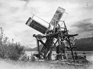 Photo courtesy of Gary Titus. This photo, taken most likely in the 1930s, shows Andy Anderson climbing/working on the windmill he built on his Caribou Island homestead on Skilak Lake. Anderson used the windmill to pump water from the lake and to power his sawmill.