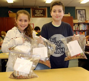 Katharine Bramante and Peyton Story show off finished bags of soup.