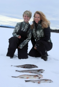 Photos courtesy of Christine Cunningham. Christine Cunningham, left, and Ruth Cusack pose with the morning's ice-fishing catch.