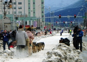 Perry and Robertia head out of downtown Anchorage in the ceremonial start of the Iditarod on Saturday.
