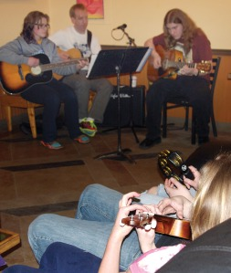 Photos by Jenny Neyman, Redoubt Reporter. The Soldotna Stars Guitars group, representing guitar classes at Soldotna High School, perform at Kaladi Brothers earlier this month.