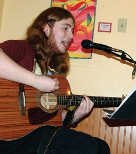 Ryan Reid, a senior at Soldotna High School, performs at Kaladi Brothers. He's been taking guitar classes since freshman year and is recording an album with his band, Magnum Opus.