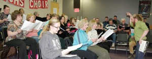 Photos by Jenny Neyman, Redoubt Reporter. Kenai Central High School choir teacher Simon Nissen directs the Kenai Peninsula Singers Community Choir in a rehearsal before their concert last week. Participation has been a smashing success throughout the year.