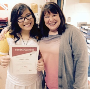 Photo courtesy of Tiffany Loepz. Nikiski High School senior Tiffany Lopez shows off her letter of recognition as a Gates Millennia Scholar with teacher Laura Niemczyk. The scholarship covers all costs for Lopez to pursue postsecondary schooling, all the way through graduate school.