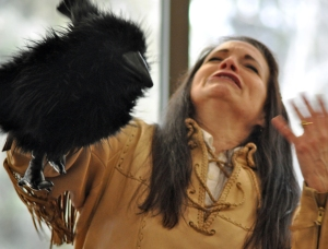 Photos by Joseph Robertia, Redoubt Reporter. Bunny Swan Gease, a Kenaitze Indian Tribe member, utilizes puppets to share an energetic tale, at the Alaska Native Oratory Society's seventh annual regional event, held Friday at Kenai Peninsula College's Kenai River Campus.