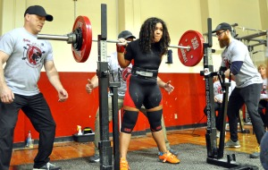 Photos by Joseph Robertia, Redoubt Reporter. Robin Johnson, a 16-year-old sophomore at Soldotna High School, squats 330.5 pounds Saturday during the Kenai Peninsula Powerlifting Challenge 2015. She also bench pressed 187 pounds and dead lifted 347 pounds. Johnson is one of two teens hoping to bring home the gold in their division during the 2015 Raw World Championship held in June in Salo, Finland.