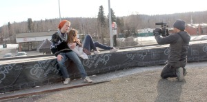 """Jon Taylor films Conway Seavey and Delana Duncan in February on the roof of Pizza Boys in Soldotna for Seavey's music video to Maroon 5's """"Payphone."""""""