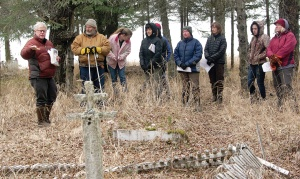 Photos by Jenny Neyman, Redoubt Reporter. Dr. Alan Boraas, professor of anthropology at Kenai Peninsula College, leads a tour of Kalifornsky Village last month. The Native settlement was abandoned in the 1920s but is still home to a rich cultural history.