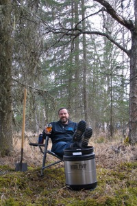 """Photo courtesy of Elaine Howell. Doug Houge, one of the owners of Kenai River Brewing Co., kicks back at what will be the site of the new brewery near the """"Y"""" in Soldotna. The expanded facility should open next May."""