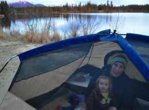 Colleen and Lynx Roberia, of Kasilof, snuggle in a tent at Peterson Lake on the Kenai National Wildlife Refuge recently.