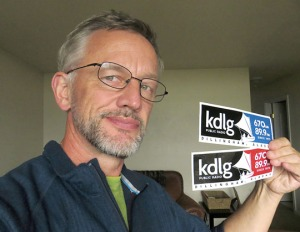 Photos courtesy of Clark Fair. Clark Fair shows his support for KDLG public radio in Dillingham.