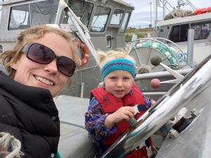 Photo courtesy of Susie Jenkins-Brito. Susie Jenkins-Brito (left) with her daughter, Bea, on the F/V Sea Breeze in 2014. The Brito family says that with cell service limited out on the water, radio stations like KDLG tailoring content to their listenership, like fishery updates and message programs, are greatly appreciated.