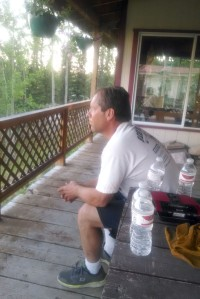 Kurt Strausbaugh watches the advance of the Card Fire from his back deck Monday night.