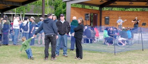Photo by Jenny Neyman, Redoubt Reporter. A crowd gathers in and out of the local beer garden to listen to live music for the June 10 Live after Five event at Soldotna Creek Park.