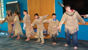 The Jabi'linia Dancers from the Kenaitze Indian Tribe perform in the conference room.