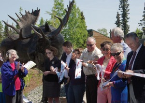 Dignitaries cut the ribbon at the grand opening ceremony of the Kenai National Wildlife Refuge Visitor Center on Saturday.