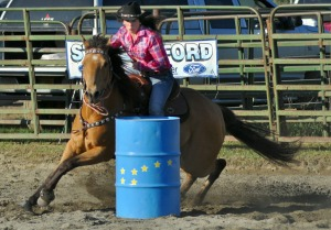 Makayla Derkevorkian, on her horse, Bobby, makes a tight turn during the barrel racing event on Friday.