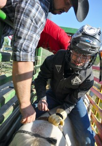 Jesse Rogde, 15, of Soldotna, prepares for his bull ride. Rogde was the youngest bull rider to compete Friday.