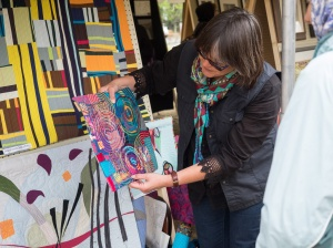 Photos courtesy of Bill Heath. Julie Drake, of Anchorage, shows off one of the art quilts that won her first place in the Alaska Emerging Artist Competition, held May 23 as part of the  Soldotna Memorial Day Public Art Festival at Soldotna Creek Park.