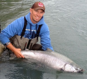 Photo courtesy of Mark Glassmaker. Kenai River fishing guide Mark Glassmaker shows off a king salmon caught by a client before releasing. He mandates all Kenai kings caught on his trips must be let go.