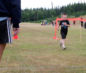 Micah Allemann trots to his second-place finish in a 1K race for kids held each Wednesday of the Salmon Run Series.