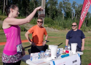 Photos by Jenny Neyman, Redoubt Reporter. Battle of Binkley organizer Bobbi Lay shows competitors Paul Ostrander, center, and Sean Dusek how much coffee they must use in the first round of the challenge.