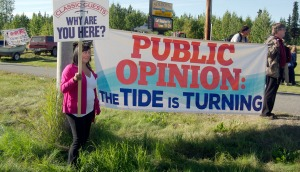 Photos by Jenny Neyman, Redoubt Reporter Demonstrators protesting the Kenai River Sportfishing Association met outside the Soldotna Sports Complex on Thursday evening while participants of the Kenai River Classic held a banquet inside. Protesters also floated with signs outside the riverfront home of founding KRSA member Bob Penney during another Classic event Aug. 19.