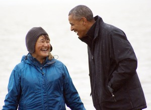 Photo by Clark Fair. Dillingham resident Mae Syvrud and President Barack Obama share a laugh at Kanakanak Beach in Dillingham on Sept. 2.