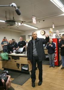 President Barack Obama makes a point about economics during a brief stop at N&N Market.