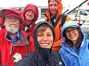 Photo courtesy of Hannah Colton. A group selfie of the raingear-clad members of the local press pool during President Barack Obama's visit to Dillingham on Sept. 2. Pictured (clockwise from top right) are Bob Waldrop of the Bristol Bay Regional Seafood Development Association, Lisa Demer of Alaska Dispatch News, Hannah Colton of KDLG radio, Bob Hallinen of Alaska Dispatch News, and Clark Fair.