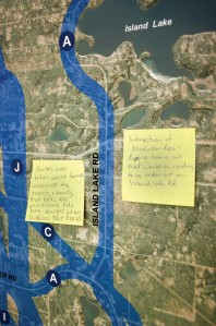 Attendees to a community meeting put on by AK LNG Monday in Nikiski were asked to leave comments on maps showing options for a reroute of the Kenai Spur Highway around the proposed new plant that would be the terminus of a natural gas pipeline from the North Slope.
