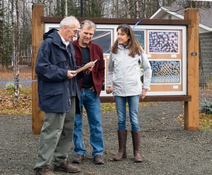 Photo courtesy of Mark Dixson, city of Soldotna. Soldotna Mayor Pete Sprague, left, presents a plaque to Kelly Keating and Geri Litzenberger at the ribbon-cutting for the new Soldotna Art Park, in appreciation of their contributions to the construction and design of the installation.