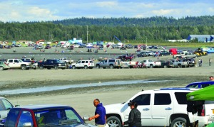 Redoubt Reporter file photos by Joseph Robertia Above, crowds of dip-netters park on the beach at the mouth of the Kenai River in a previous fishing season. The Alaska Department of Natural resources is proposing a parking lot and other developments to help prevent some of the environmental harms, such as the littering, at right, that occur from the area's  increasing use.