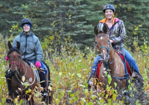 Photos by Joseph Robertia, Redoubt Reporter. Jayne Hempstead, of Cantwell, and Katie King, of Nikiski, ride together during the inaugural Midnight Sun Challenge endurance ride, an equine distance event which took place in Nikiski on Saturday.