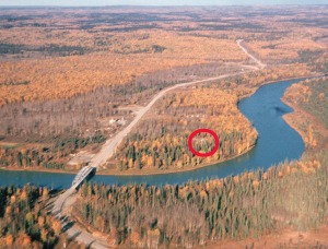 Photo courtesy of Al Hershberger. This aerial photo of Soldotna from 1951-52 shows Soldotna in its infant stage. The red circle indicates the location of Howard Binkley's home. Binkley homesteaded most of the inside of the river meander pictured here. In the mid- to late 1950s, he sold his homesite and left Alaska.