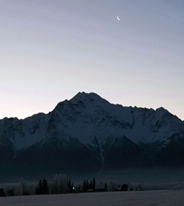 Photo courtesy of Susan Mircovich, Kenai Peninsula College.  Venus emerging from its lunar occultation, pictured in front of Pioneer Peak along the Knik River on Dec. 7.